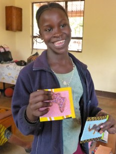 Levina shows off her cards...