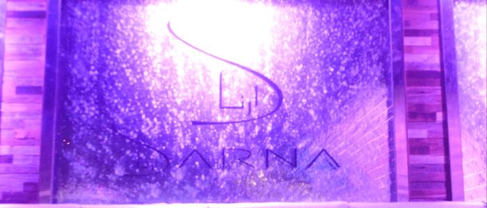 waterfall over the Darna logo