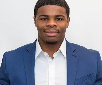 Malik Banks is a Buyer Success Agent for the Orange Line Living Team