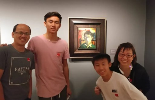 Chwen and family in front of her father's art.