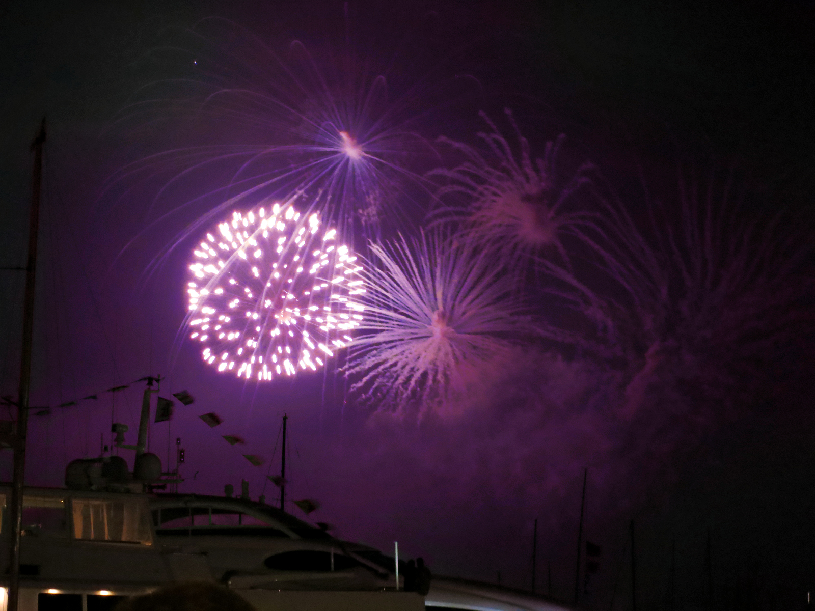 ROCKET'S RED GLARE OVER NEWPORT HARBOR - live. travel. adventure. bless. | Bright purple firework lighting up the sky over Newport Harbor in Newport, RI. Happy 4th of July!