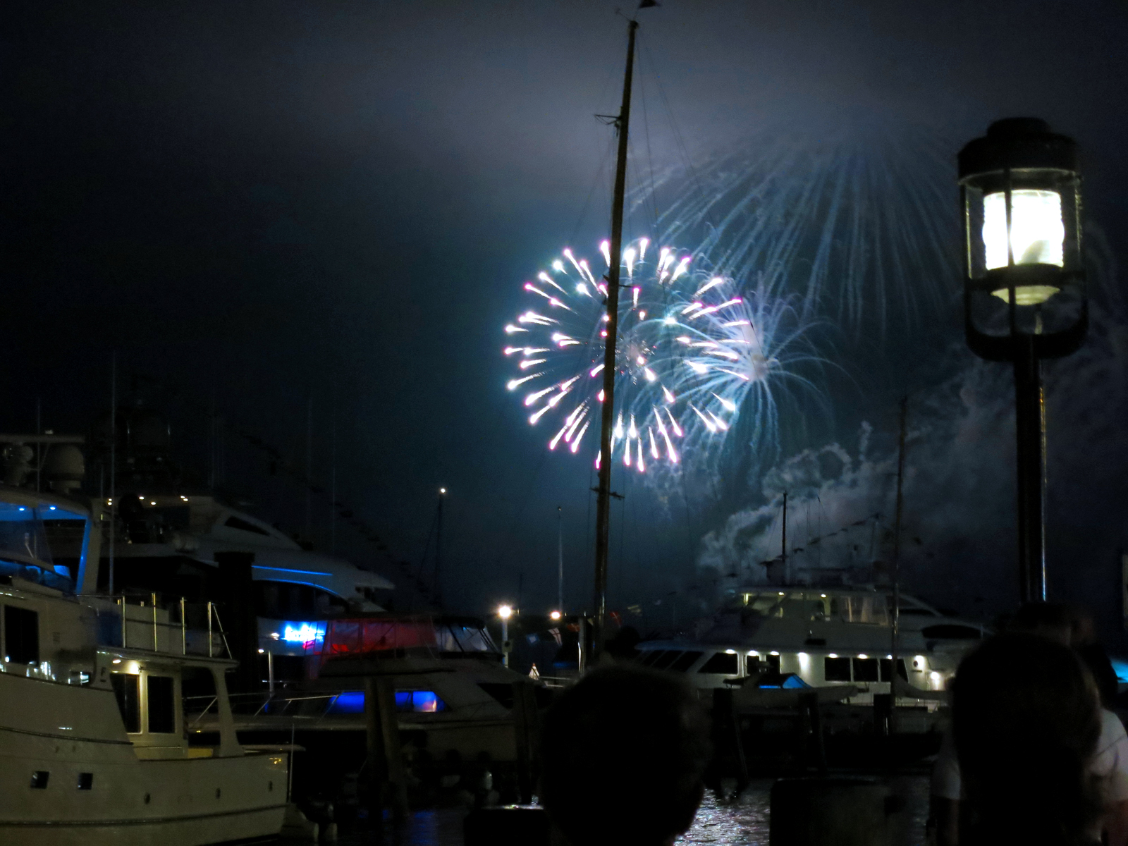 ROCKET'S RED GLARE OVER NEWPORT HARBOR - live. travel. adventure. bless. | Bright multi-colored firework shining over Newport Harbor during the Independence Day fireworks in Newport, RI. Happy 4th of July!