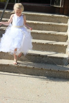 flower girl at wedding coming down stairs