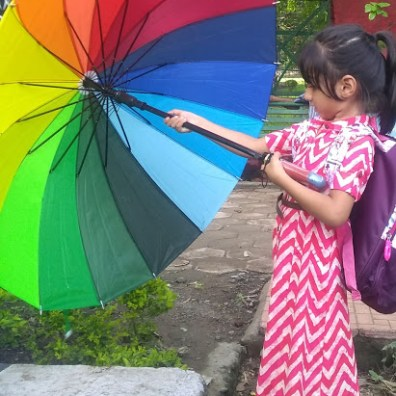 A young child opening a rainbow umbrella at the Bhopal Pride Parade, 15 July 2018. Credit: Aishwarya Shrivastav