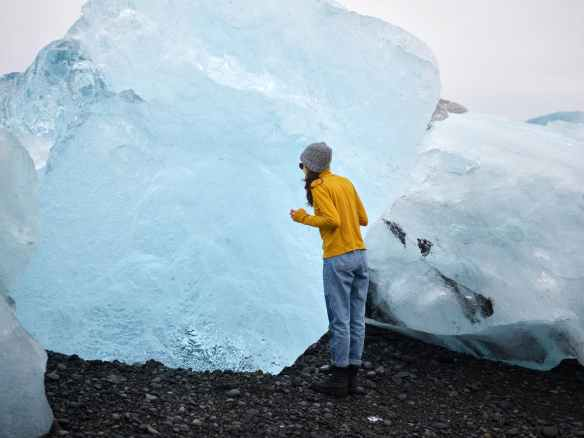 female traveler viewing huge ice chunk
