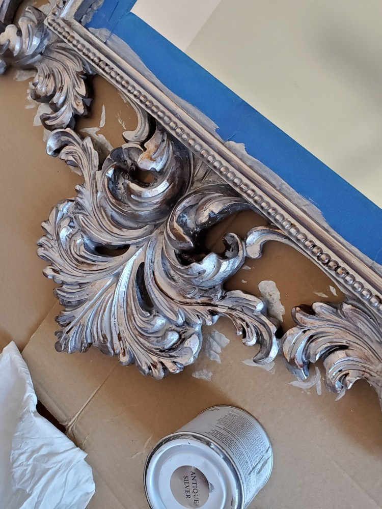Close up picture of mirror with metallic paint