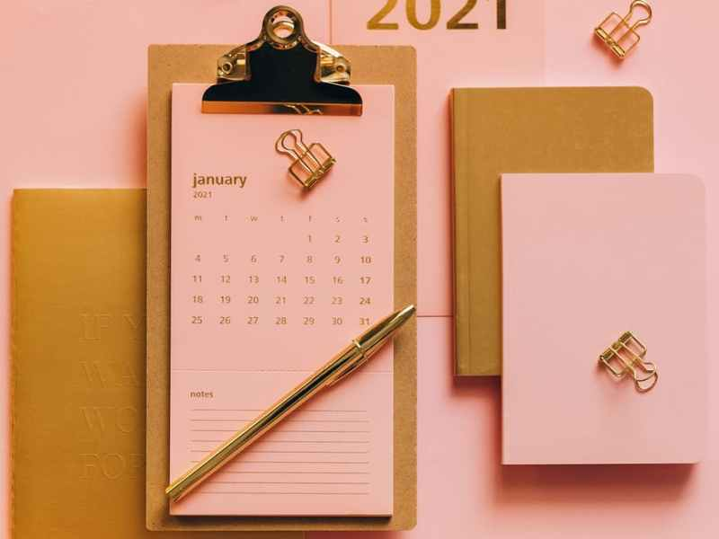 composition of stylish supplies on pink background