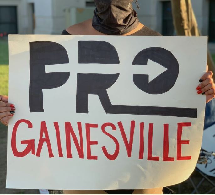 GAINESVILLE POLICE ISSUE ARREST WARRANTS AND HOTLINE, TARGET NON-VIOLENT PROTESTERS FOR WALKING IN STREETS
