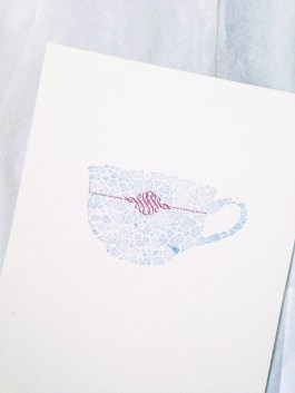 One in a series of five teacups letterpressed with a mosaic of crushed eggshells and type ornaments.