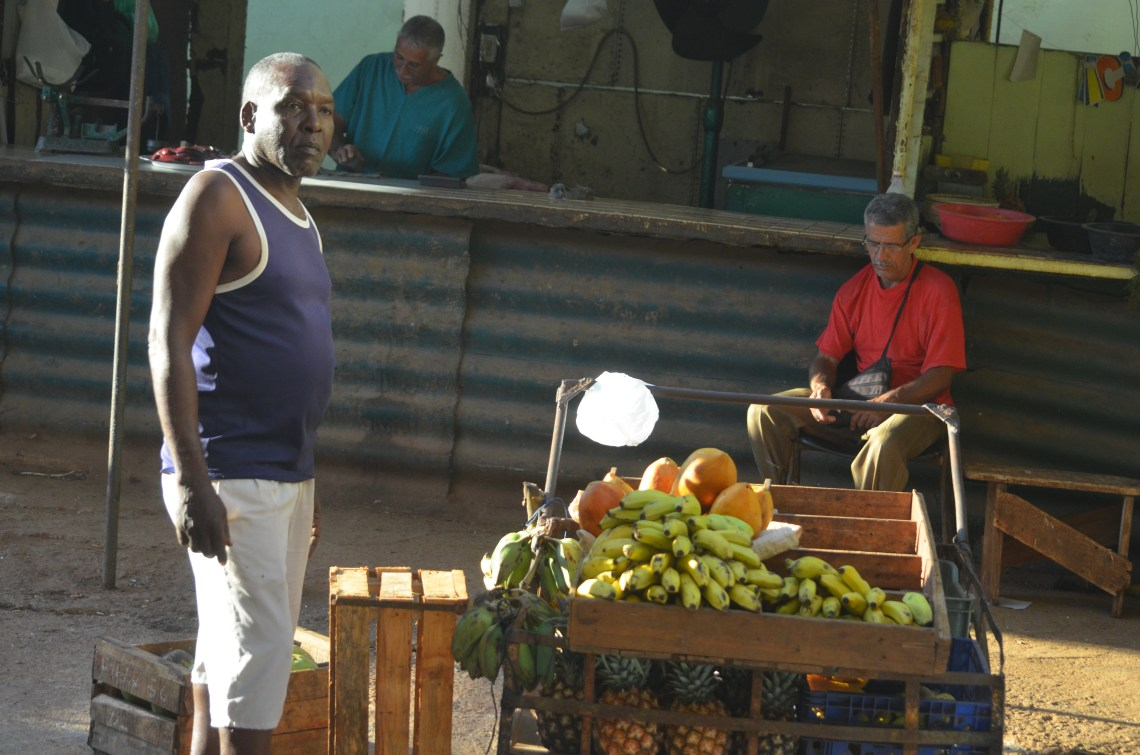 Greengrocer in a Cuban fruit market, Havana