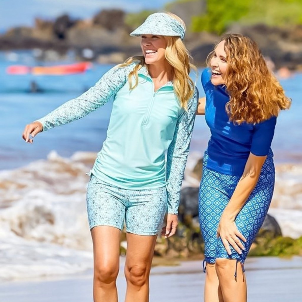 two women smiling on the beach