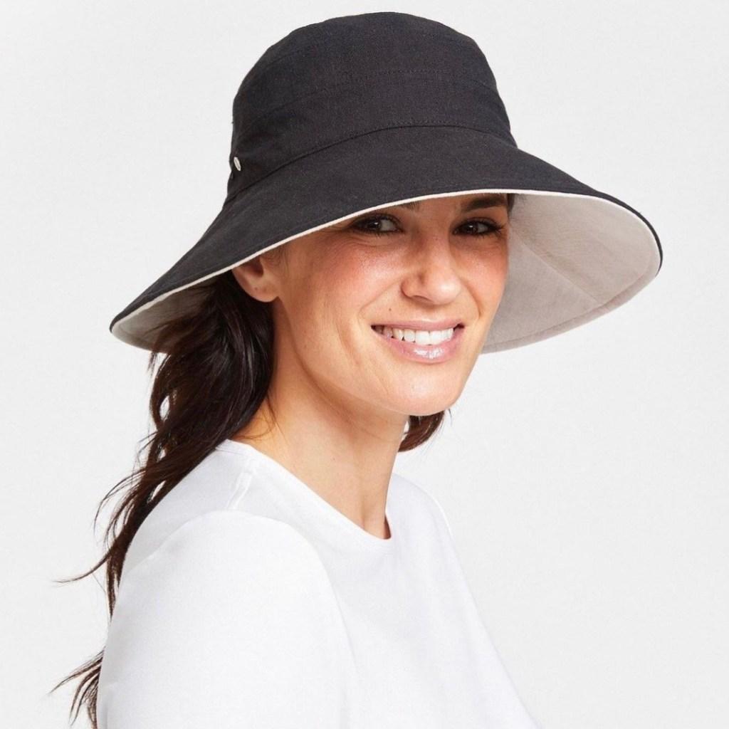 woman smiling wearing hat