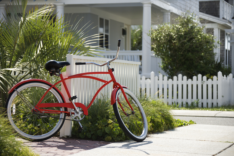 Red Bicycle in Front of a Home with McKinney Realty Group