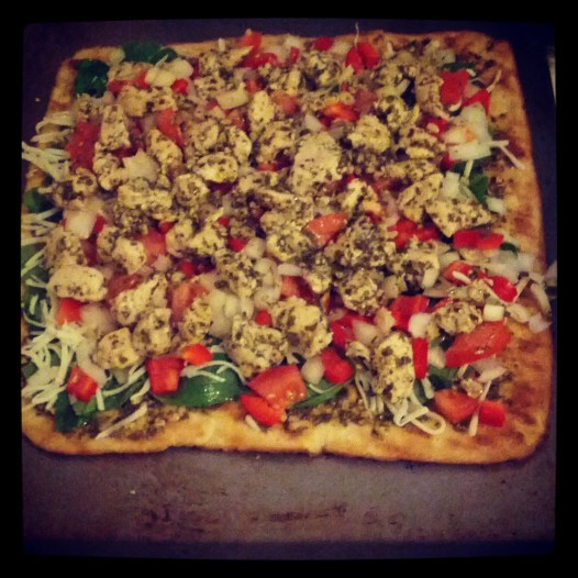 Presto Pesto Pizza: 1 whole grain pizza crust, 3 tbs pesto sauce, 1-2 cooked chicken breasts (thinly sliced), 1 tomato (sliced/chopped thin), 1 cup sliced green peppers, 3 tbs garden vegetable Feta cheese, 1 cup mozzarella cheese, 1/4 cup chopped onion, 2 tbs pesto sauce to cover. Cook on 350 for 10-15 minutes (check often!)