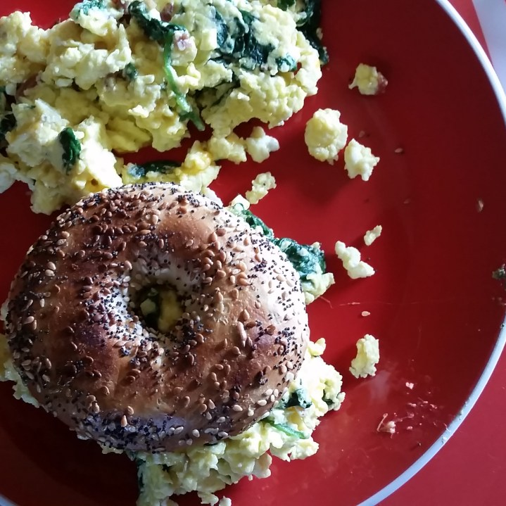 Pesto, Egg & Cheese Bagel: Ingredients: 2 eggs, 1 everything bagel, 3 tbsp pesto sauce, 1/4 cheese. Optional: 1/4 cup chopped onions, green peppers, 1 cup spinach.