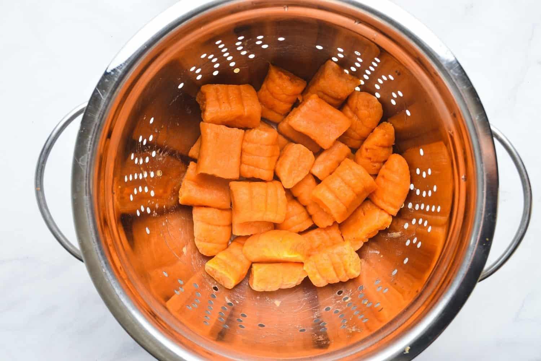 Drain gluten free Sweet Potato Gnocchi