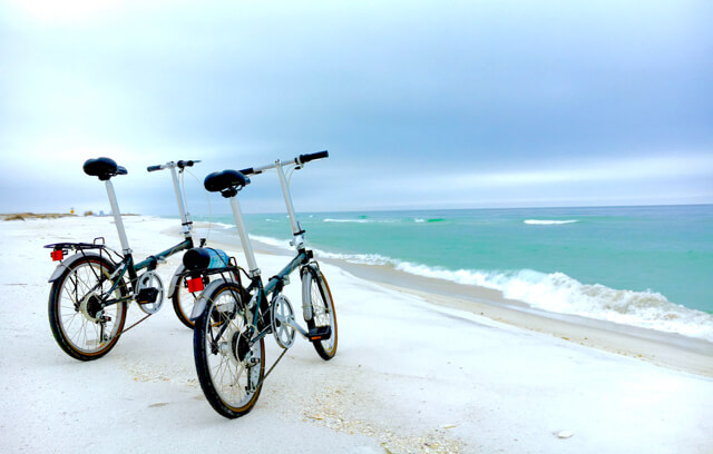 Our new (to us) folding bikes at Ft Pickens Gulf-side beach