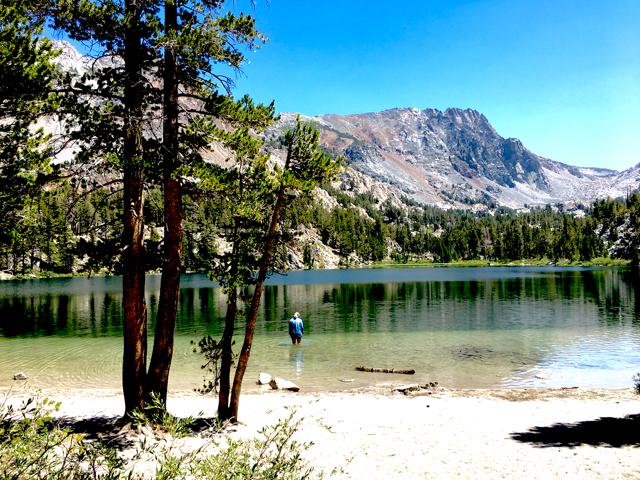 Carmen wades in a mountain lake in Mammoth Lakes, California