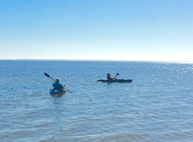 Carmen and her dad kayaking the Gulf at Ho Hum RV Park