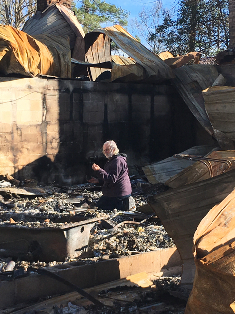 Jim digs through the rubble