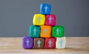 Ten clay cubes stacked on each other with the outline of a person on each one. Use programs from Human Resources for the downpayment for you house.