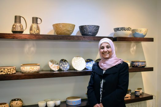 Terracotta owner Enshera in front of her items in the showroom, Amman Jordan