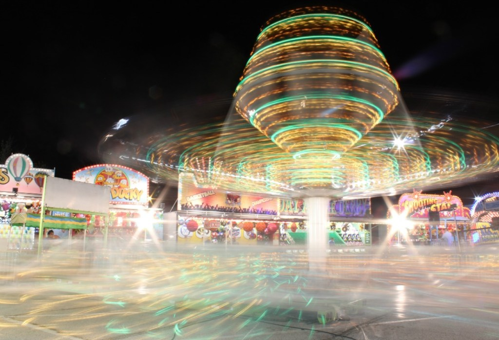spinning carnival ride in motion
