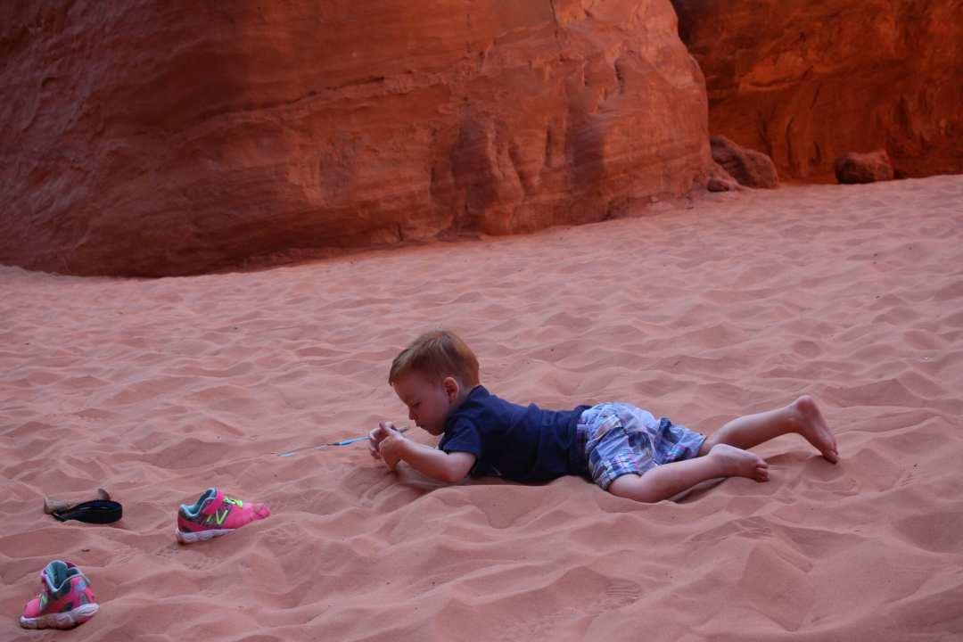 Alex swimming in the sand.