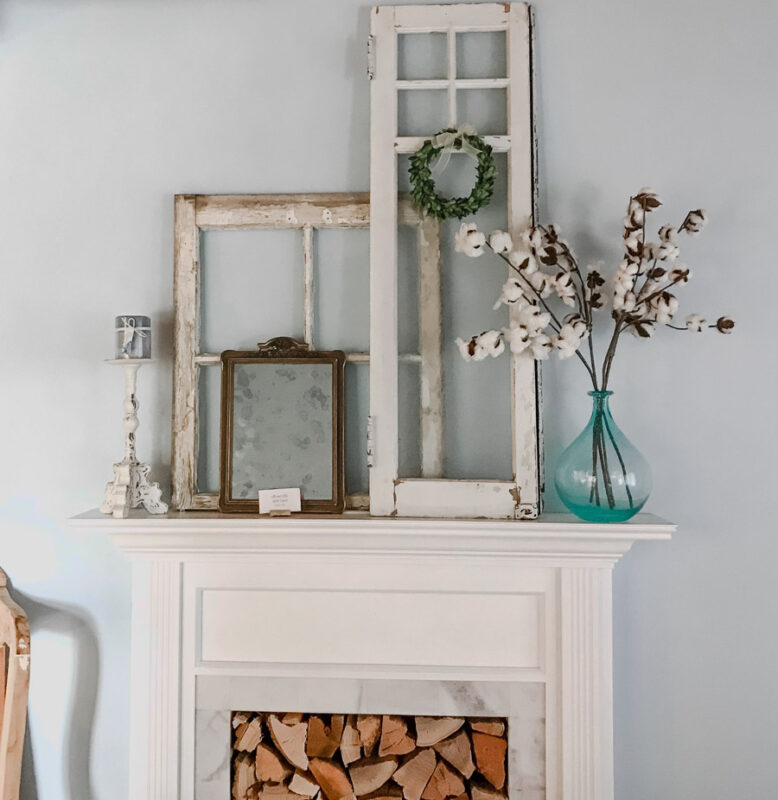 White Faux Fireplace mantel made by handy husband with vintage decor on top of mantel