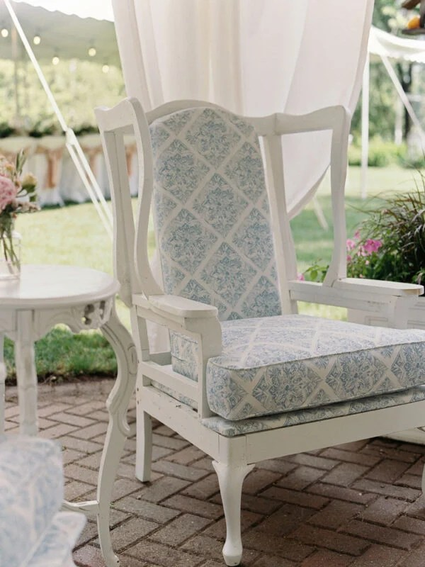 Deconstructed wing back chair with blue and white upholstery on cushion and back