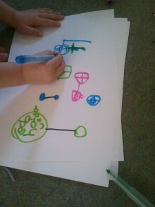 She decided to draw the characters from the wipe clean book having a birthday party.