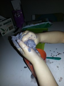 Experimenting with play dough and water- exploring properties