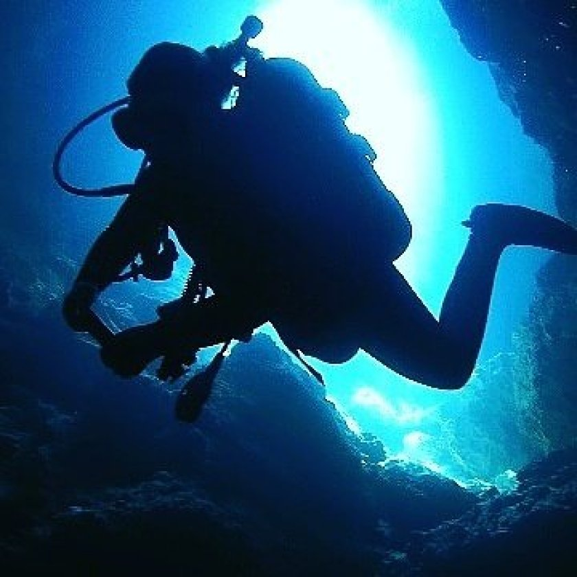 A photo of Grace scuba diving.