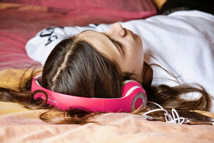 Girl sleeping with headphones on