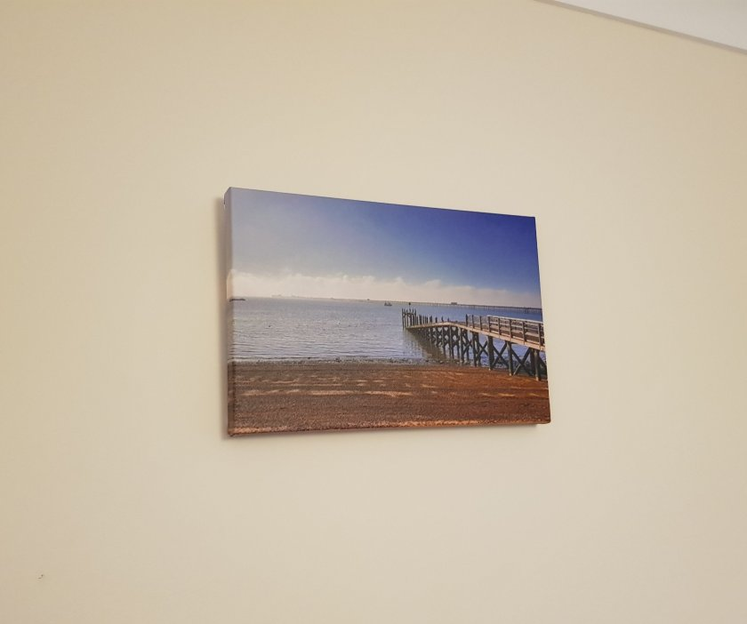 Canvas hanging on wall. Wrap sides