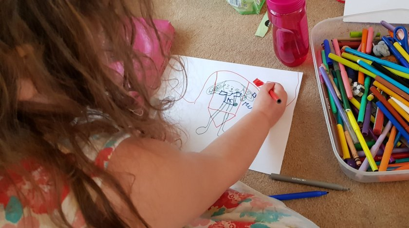 Squiggle drawing with art supplies