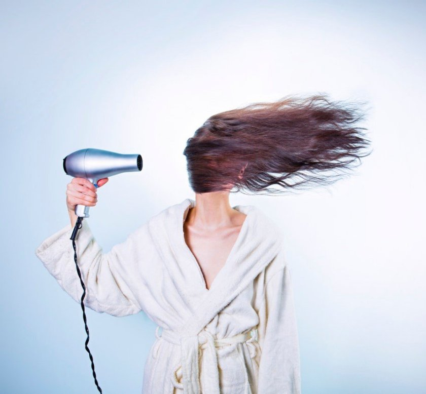 A lady drying her hair