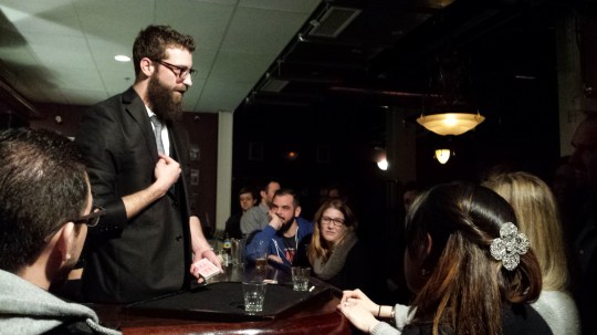 This bar magician was making wagers with people.
