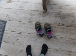 My shoes, covered in dirt, and my socks with new holes in them. Evidence of our haunting ordeal.