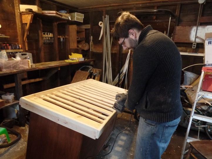 Sanding the adjustable height mattress frame.