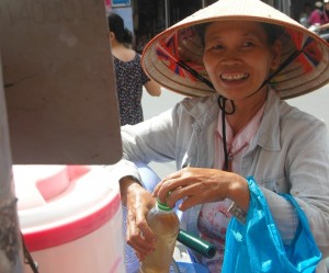 """A Lady is happy with her """" Free Ice tea"""""""