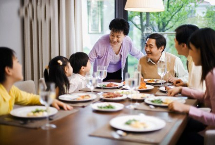 Family Around Dinner Table --- Image by © Randy Faris/Corbis