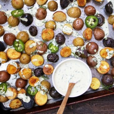 homemade ranch dressing drizzled over roasted potatoes and Brussels sprouts