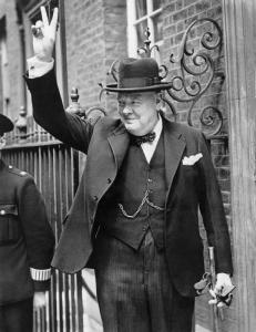 "Winston Churchhill displaying a ""V"" with hands"