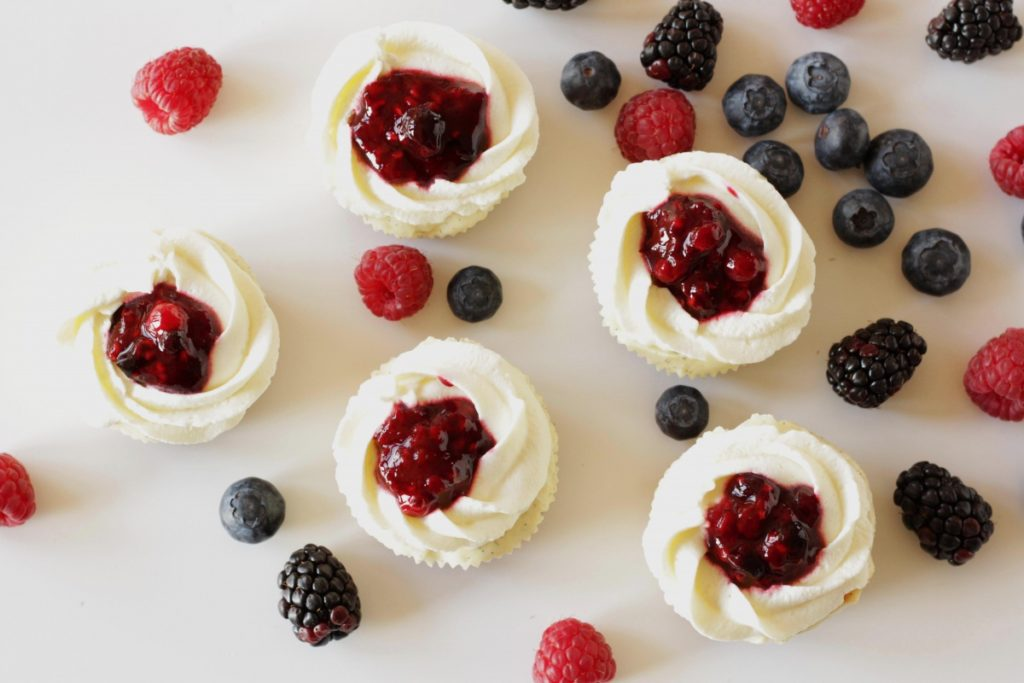 Cheesecake Cupcakes with Berries & Cream ~ Living on Cookies