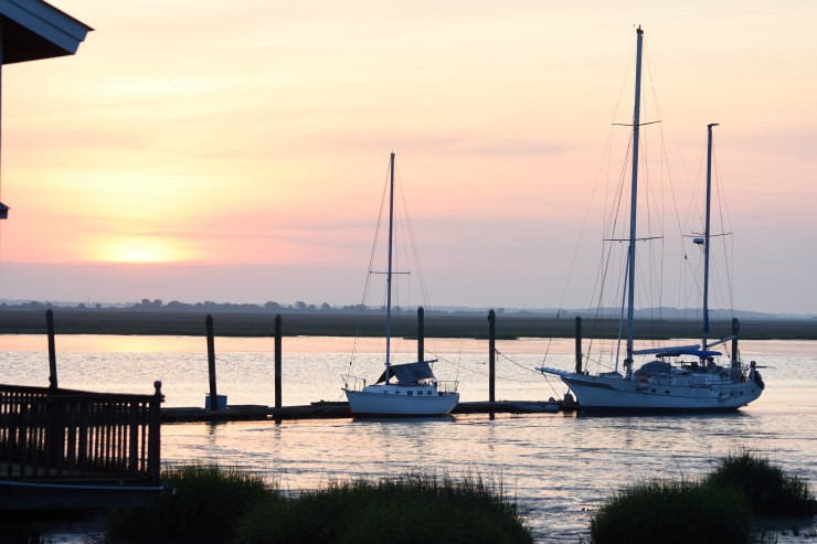 sunset at Latitude 31 sailboats