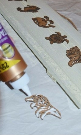 sea animals wall art step 2 - glue wooden animals onto board