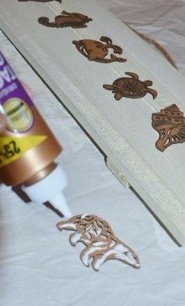 sea animals wall art step 2 - glue wooden animals onto board