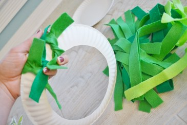 paper plate wreath craft - tie felt strips and slide