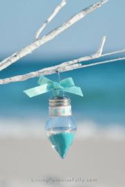 turquoise aqua sand and shells in clear light bulb ornament